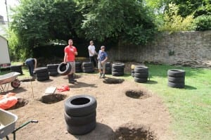 Sorting the car tyres into equal heights.