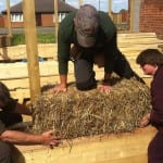 Placing the first straw bale