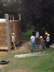 Compressing straw bale walls